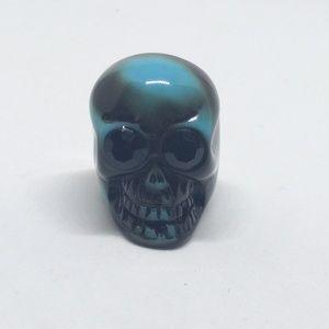 skull resin ring with black rhinestone eyes
